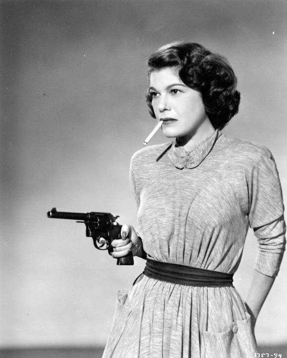Photo of Betty Lou Gerson carrying a gun with a cigarette dangling from her mouth from the 1950 movie The Red Menace