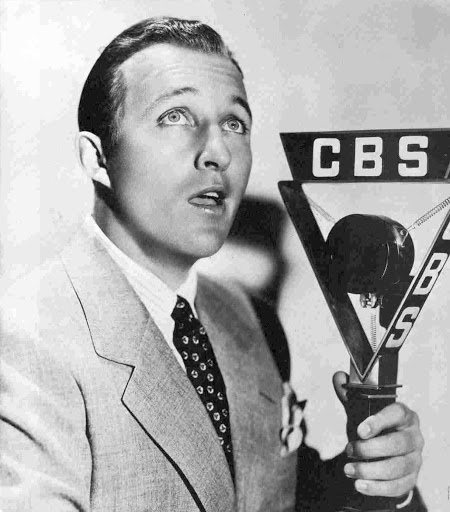Photo of Bing Crosby performing on a CBS radio microphone