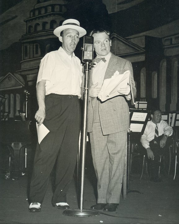 Photo of Bing Crosby and Jimmy Cagney performing Command Performance on stage August 30, 1942
