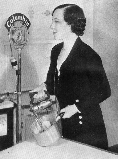 Ida Bailey Allen using a mixer in a bowl at a Columbua radio microphone