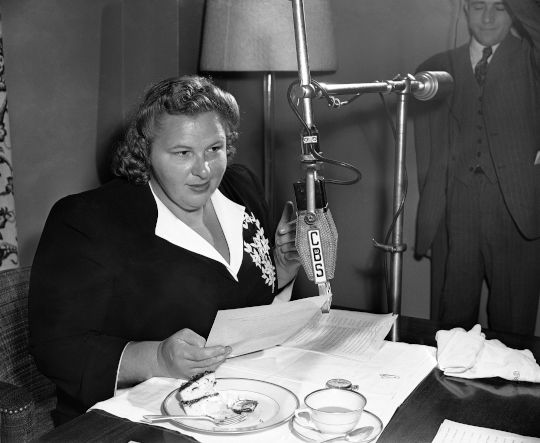 Kate Smith at a CBS radio microphone