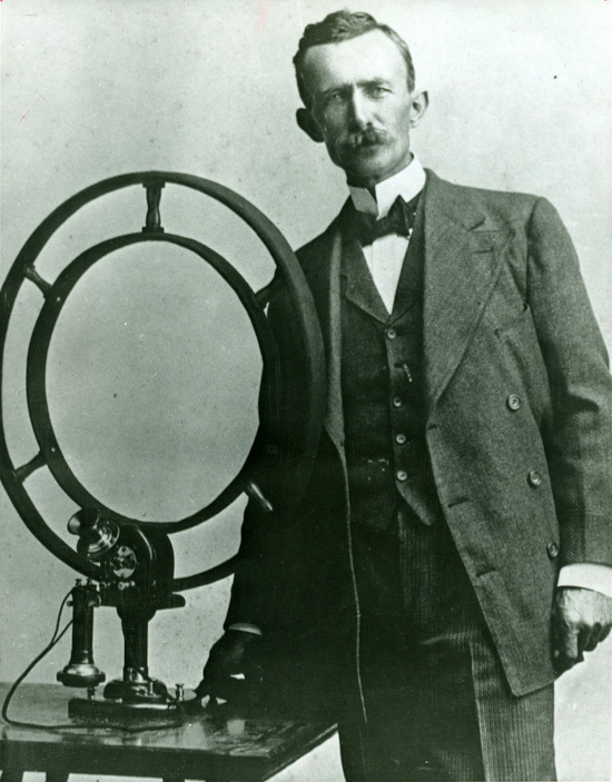 Nathan B. Stubblefield standing beside his invention in 1908