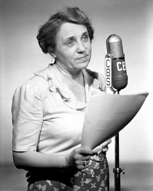 Tess Sheehan at a CBS radio microphone
