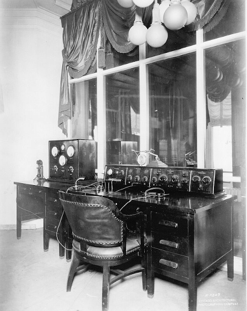 Photo of the broadcast control desk at WJAZ in 1922, consisting of 15 dials, five gauges and other equipment